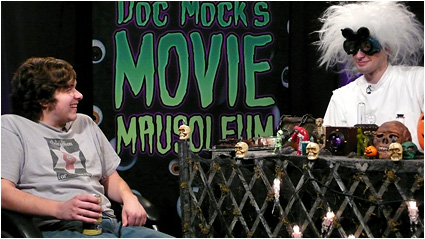 Doc Mock and guest Josh Simpson enjoy some cheesy cinema gold!